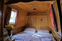 The King sized double bed, in its own private room
